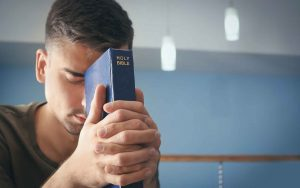 Religious-young-man-with-Bible
